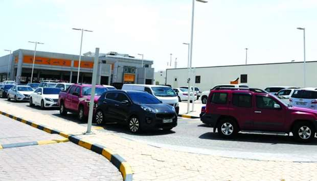A long queue of vehicles at the Mesaimeer Fahes centre Monday.