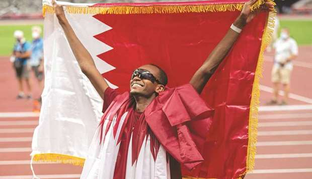 Qatar's Mutaz Essa Barshim celebrates after winning gold in the men's high jump event at the Tokyo O