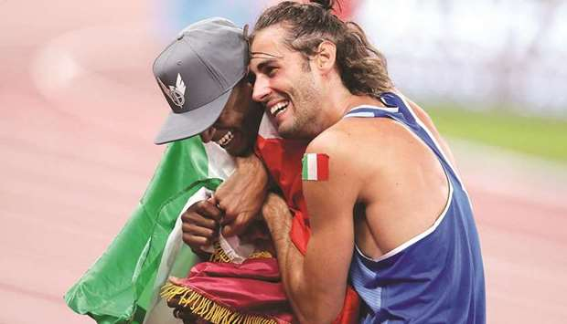 Qatar's Mutaz Essa Barshim (left, also right) of Qatar and Gianmarco Tamberi of Italy celebrate afte