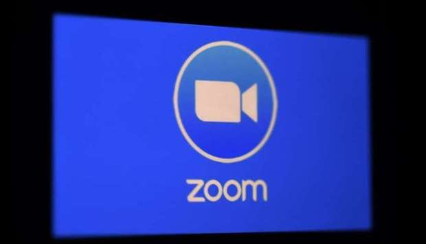In this file photo illustration taken on March 30, 2020, a Zoom App logo is displayed on a smartphon