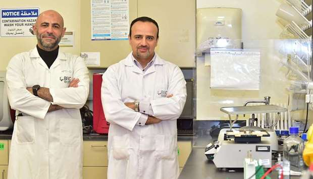 Dr Mohamed Elrayess and a researcher from the Biomedical Research Centre at QU.