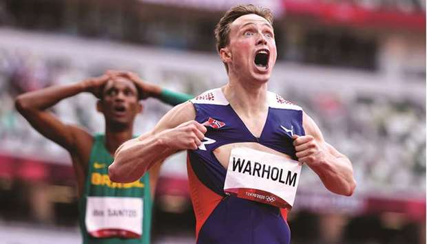 Karsten Warholm (also inset) of Norway celebrates after winning the men's 400m hurdles gold in a
