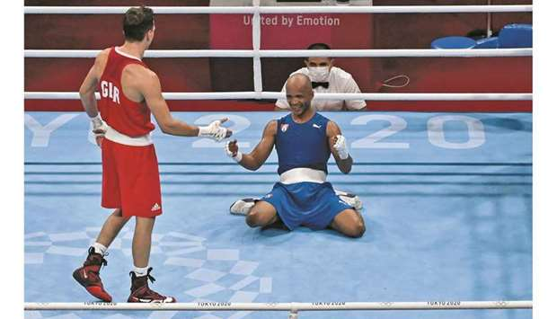 Cuba's Roniel Iglesias (right) celebrates after winning against Britain's Pat McCormack after their