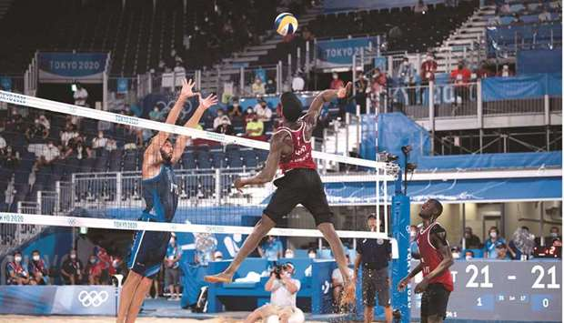 Qatar's Ahmed Tijan (left) and teammate Cherif Younousse celebrate their quarter-final win on Wednes