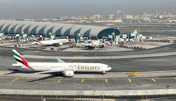 Emirates airliners are seen on the tarmac in a general view of Dubai International Airport in Dubai