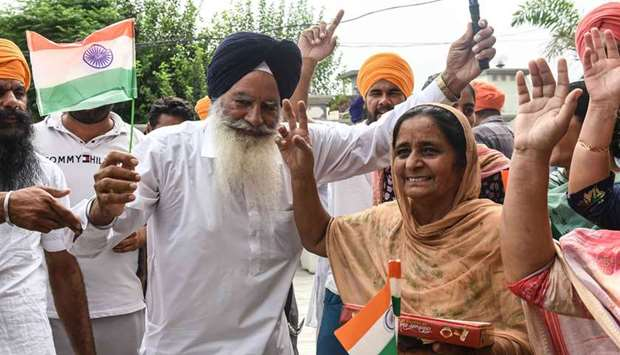 Father Baldev Singh along with his wife Sukhjinder Singh and relatives of hockey player Gurjant Sing