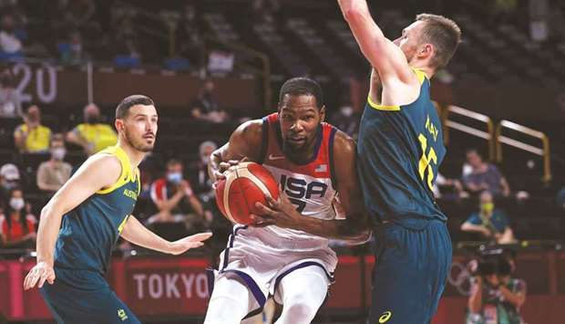USA's Kevin Durant (centre) attempts to score past Australia's Chris Goulding (left) and Nic Kay dur