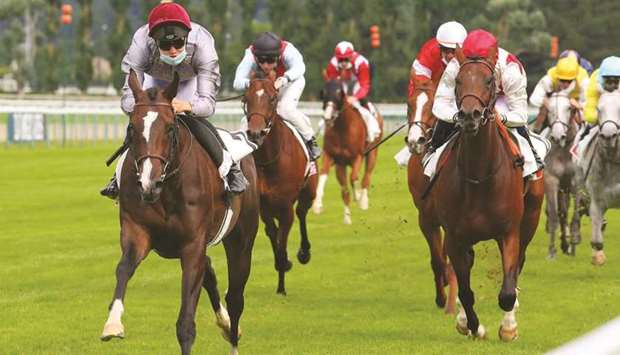 Hugo Besnier (left) rides Shaikha to victory in the Prix Equidia — Prix de Lisieux in Deauville, Fra