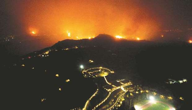 A wildfire approaches the Olympic Academy in ancient Olympia, western Greece.