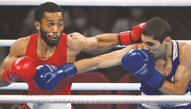 USA's Duke Ragan (left) and Russia's Albert Batyrgaziev exchange punches during the men's featherwei