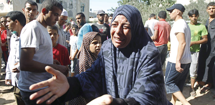 A woman reacts outside her home after  an Israeli air strike yesterday in Khan Younis.