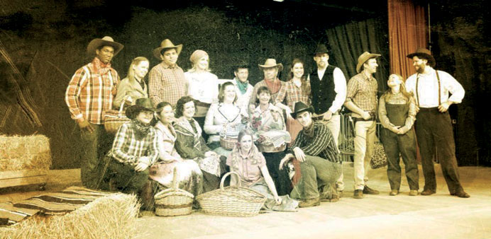 Cast of Oklahoma! gather for the box social.