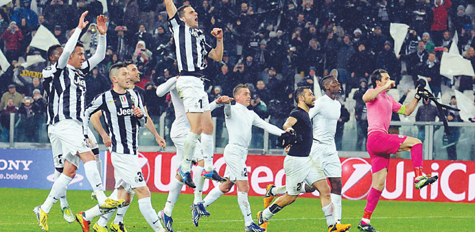 Juventus players celebrate after beating Celtic in the UEFA Champions League round of 16 second leg