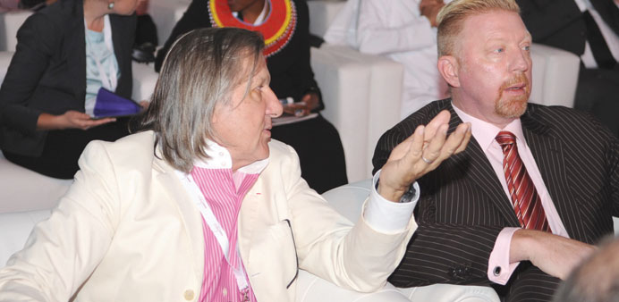Former world no. 1 tennis players Romania's Ilie Nastase (left) and Germany's Boris Becker in conver