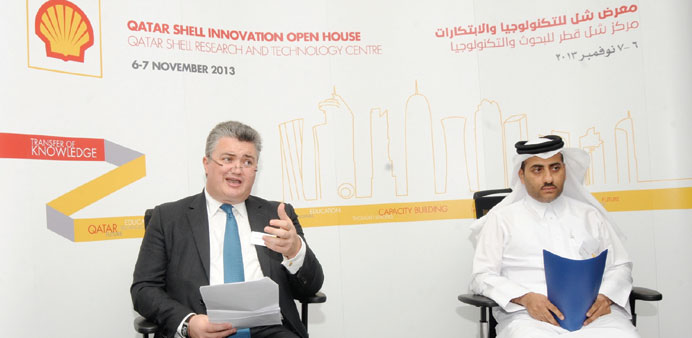 Shell Gas Technology vice president John MacArthur and QSRTC managing director Youssef Saleh addr