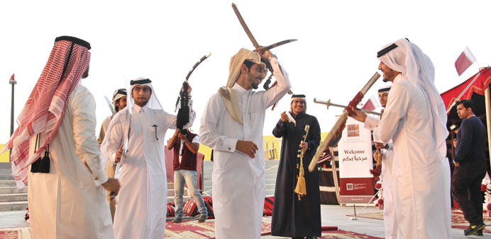 Traditional sword dance at ABP celebration of Qatar's National Day.