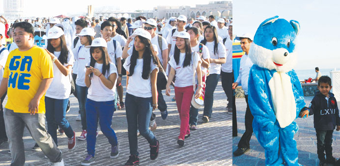 The walkathon gets underway. Right: Cartoon characters entertained children at the event.