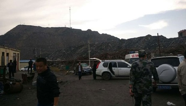 Rescue workers at the site of explosion. Picture courtesy: People's Daily, China