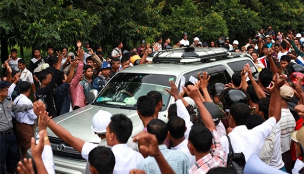 Protesters shout slogans during a rally against former UN chief Kofi Annan in Sittwe