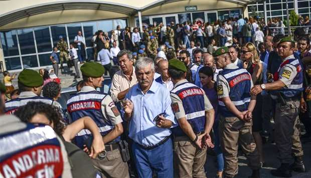 Turkish gendarmes stand guard in front of the courthouse before the controversial trial of staff fro