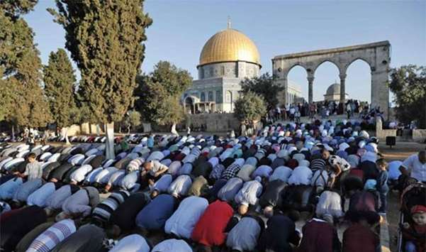 Palestinians pray on the first day of Eid al-Adha near the Dome of Rock inside the Al-Aqsa compound
