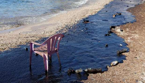 Oil that leaked from an oil tanker that sank on September 10, is seen on a beach on Salamina island
