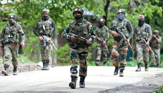 Soldiers conduct a patrol in Kashmir. File picture