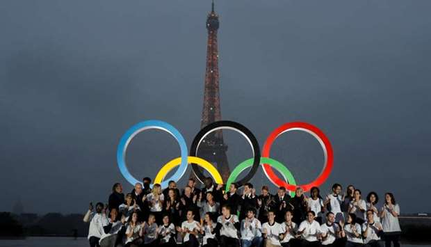 Parisians, athletes and officials pose in front of Olympic rings to celebrate the IOC official annou