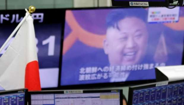 Monitors showing TV news on North Korea's threat