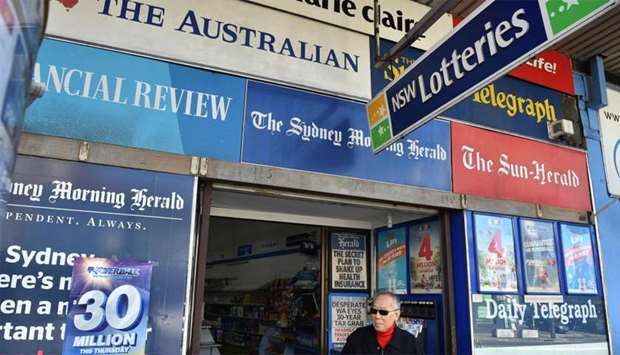 A man leaves a newsagency shop in Sydney