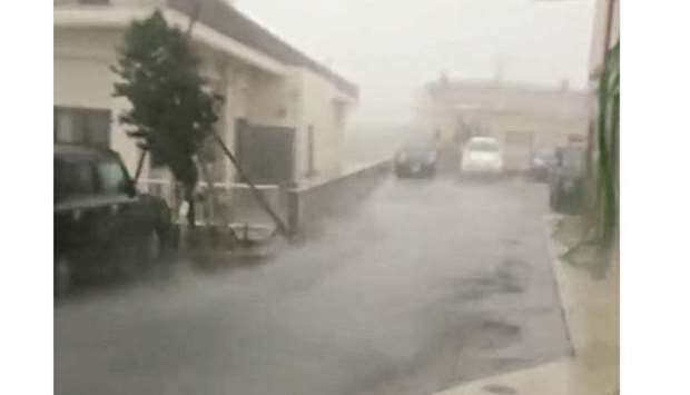 Strong wind and rain are brought by Typhoon Talim in Miyakojima, Japan, yesterday, in this still gra