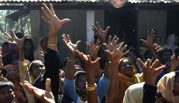 Rohingya Muslim refugees scuffle for relief supplies at Kutupalong refugee camp in Bangladesh's Cox'