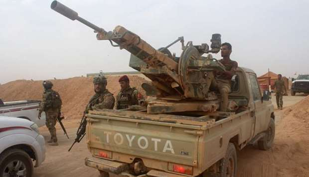 Iraqi forces are seen outside the town of Akashat, northwest of the al-Anbar province