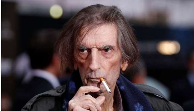 """Harry Dean Stanton smokes a cigarette as he poses at the world premiere of the film """"Marvel's The Av"""