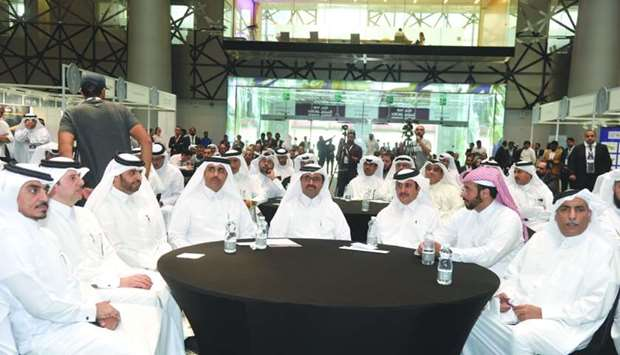HE the Minister of Energy and Industry Dr Mohamed bin Saleh al-Sada (centre), with QDB CEO Abdul Azi