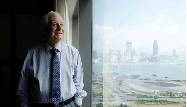 Former Hong Kong governor Chris Patten poses during an interview in Hong Kong, China