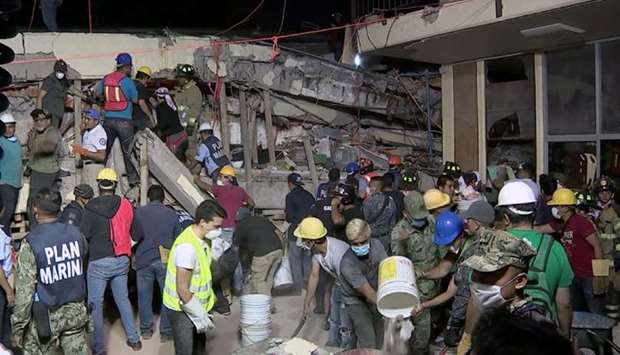 Rescue teams looking for people trapped in the rubble at the Enrique Rebsamen elementary school in M