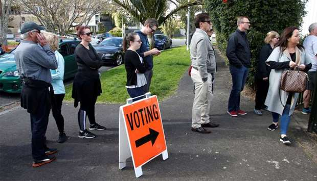 Voters wait outside a polling station at the St Heliers Tennis Club during the general election in A