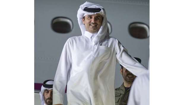 His Highness the Emir Sheikh Tamim bin Hamad al-Thani getting off the aircraft at Doha airport