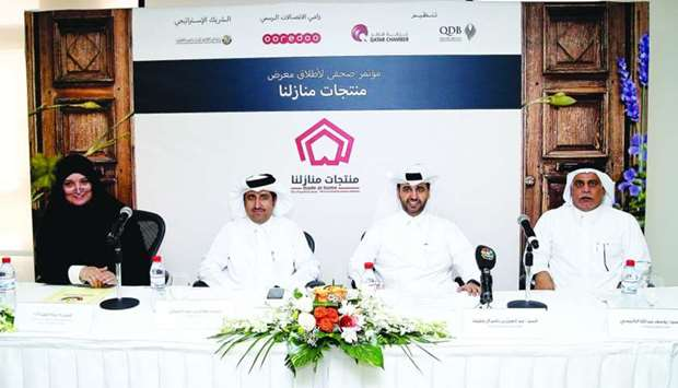 QBD CEO Abdulaziz bin Nasser al-Khalifa is flanked by (from left) Najat al-Abdullah, head of the Dep