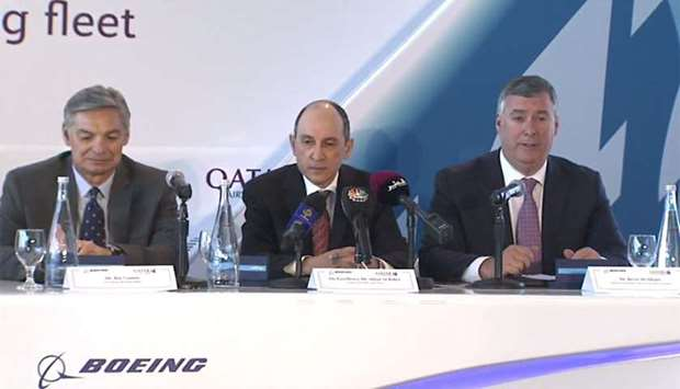 Qatar Airways Group Chief Executive Akbar al-Baker (C), Boeing vice chairman Ray Conner (L) and Boei