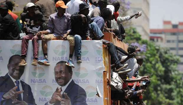 Protestors chant on the back of a campaign truck bearing the images of Kenya's opposition coalition