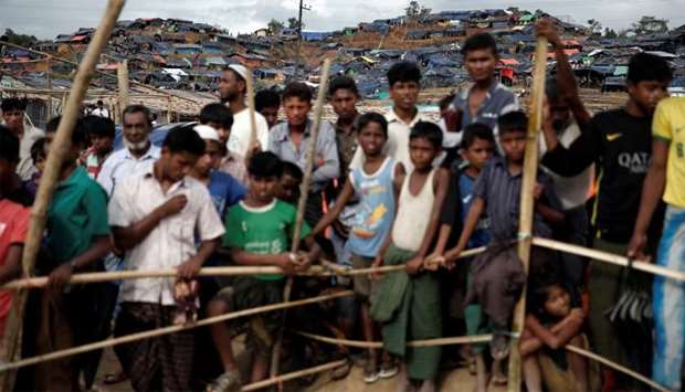 Rohingya refugees queue for aid at a camp in Cox's Bazar, Bangladesh
