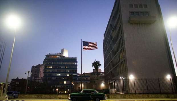 A vintage car passes by in front of the US Embassy in Havana, Cuba, January 12, 2017