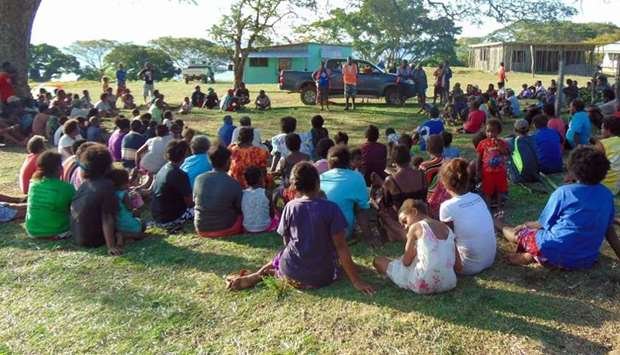 Vanuatu Red Cross personnel talking to local residents on the island of Ambae