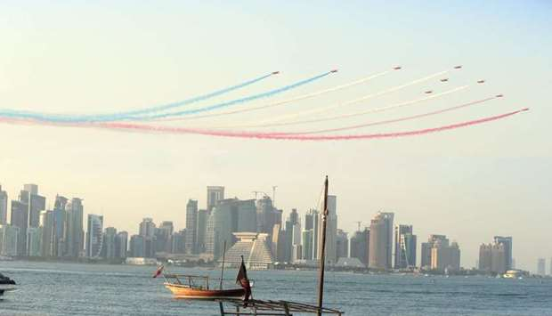 Red Arrows fly in formation over Doha Corniche