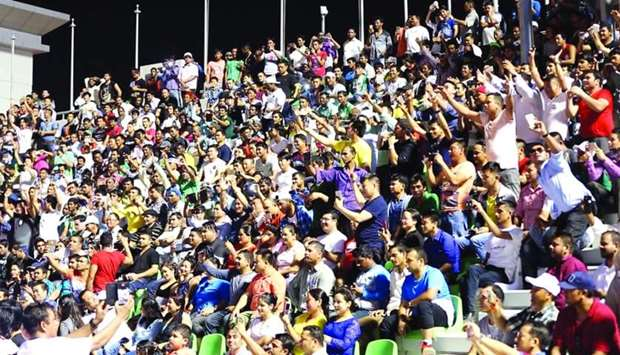 A capacity crowd enjoys an entertainment programme for the Nepalese community at Al Ahli Stadium.