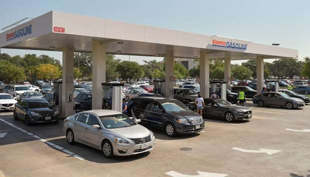 Motorist line-up for gasoline at a Costco gas station in the aftermath of Hurricane Harvey in Texas