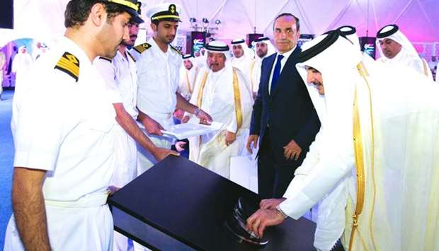 His Highness the Emir Sheikh Tamim bin Hamad al-Thani places the logo of Hamad Port marking the offi