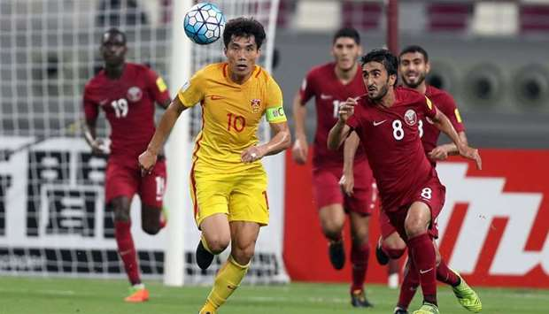 China's Zheng Zhi fights for the ball during the FIFA World Cup 2018 qualification football match be